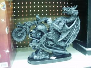 Dragon riding a motorcycle